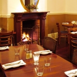 Fires keep the 1841 dining room warm all winter long